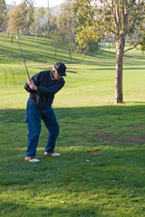 A golfer plays a round of golf at the country club resort
