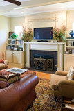 cozy living room with fireplace and plasma tv poster