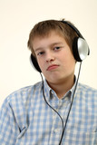 Teenager is listening to the music with headphones poster