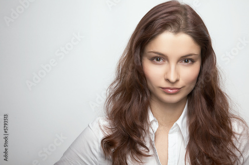 Young businesswoman on the white background