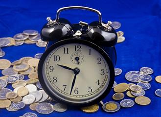 alarm clock on coins