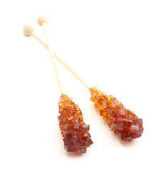 two sticks with brown sugar crystals