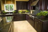 Luxury kitchen with granite counter surfaces.