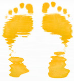 yellow abstract of two foot prints on white background