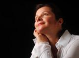 Beautiful woman gazing upward with joyful contentment poster