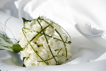 bouquet on a white dress