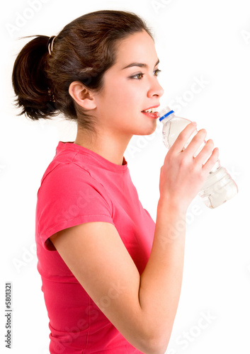 Beautiful woman Drinking Water from a Plastic Bottle