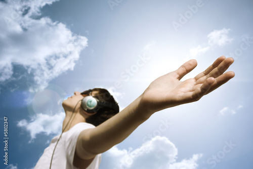 teen with headphones enjoy the music,focus point on hand