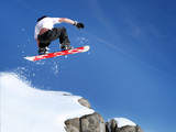 Fototapety Snowboarder jumping high in the air