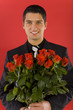 Handsome businessman with bouquet of roses in hands