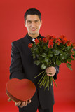 Handsome businessman, with bouquet of roses