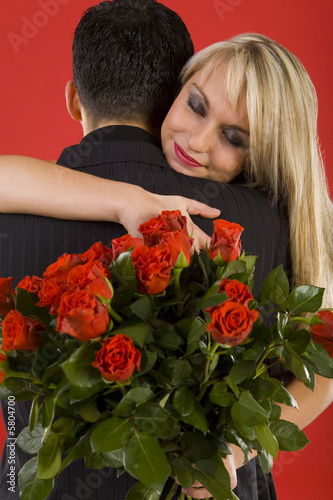 Young couple in happy hug.