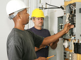 An african american and a caucasian electrician working