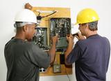 Electricians repairing breaker panel.  Actual electricians poster