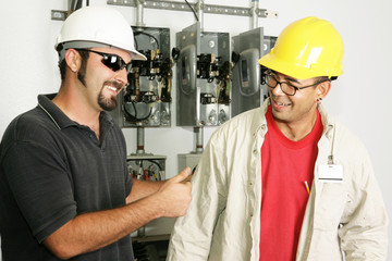 Electrical foreman giving a worker the thumbs-up.