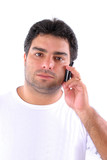 Young man hearing somebody in mobile phone . poster