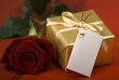 golden present with red rose close up shoot