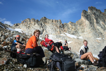 group of hikers taking a rest after descending.
