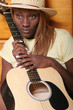 Black musician with her guitar