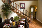 Modern dining table and hallway with hardwood flooring. poster