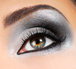 Fashion Image of woman eye with ceremonial make-up