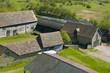 Farm buildings and farmhouse in countryside.