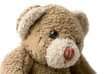 Patched teddy bear portrait - selective focus on the eye.