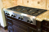 Luxury kitchen with modern stove close-up. poster