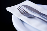 Knife and fork on napkin and plate poster