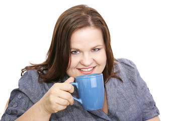 Beautiful plus-sized model enjoying a cup of coffee.