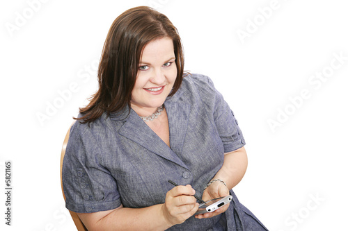 Pretty plus sized businesswoman checking  her PDA.