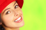Fototapety Smiling woman face. Close up. Over green background.