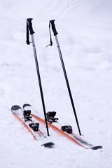Mountain skies & ski-binding on snow with nobody outdoors