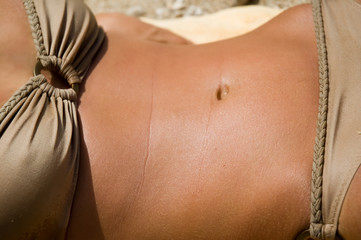 Torso of a tanned female