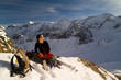 Girl relaxing in winter mountains