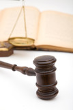 legal concept with a gavel, scales of justice and book poster