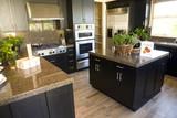 Modern Kitchen with hardwood floor. poster