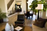Living room and hardwood floor hallway. poster