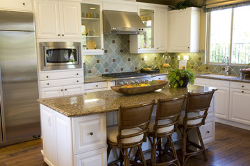 Estate kitchen with an island and modern appliances.