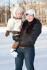 Mother and child on the ice rink