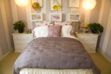 Comfortable bedroom with feminine decor theme. poster