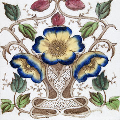 An Art Nouveau tile dating around 1890 with flower design