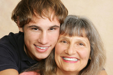 Closeup portrait of a mother and her adult/late teen son.