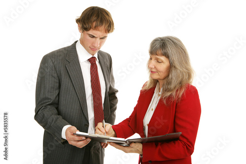 Mature female mentor and young male employee