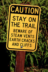 warning sign on trail near volcano in Hawaii