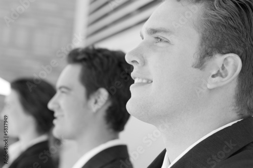 Close-up of three business people looking in same direction