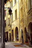 Narrow medieval street in town of Perigueux, France-