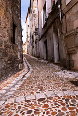 Narrow medieval street in town of Perigueux, France