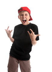 Revved up boy doing hand signal represent rock n roll.