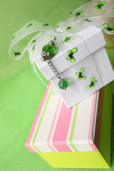 Pink gift box and white box with ribbon and pin